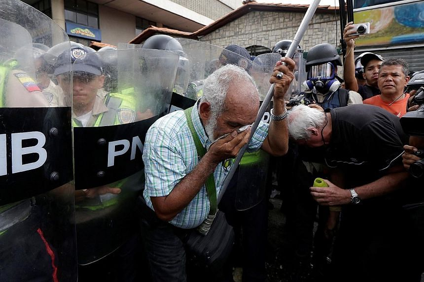 Elderly supporters of the opposition in Venezuela were pepper sprayed by riot security forces during an anti-government protest in Caracas on Friday.