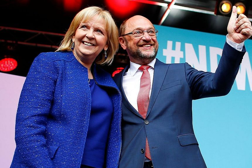 North Rhine- Westphalia premier and SPD candidate Hannelore Kraft campaigning with party leader Martin Schulz on Friday, their last rally ahead of today's election in the German state.