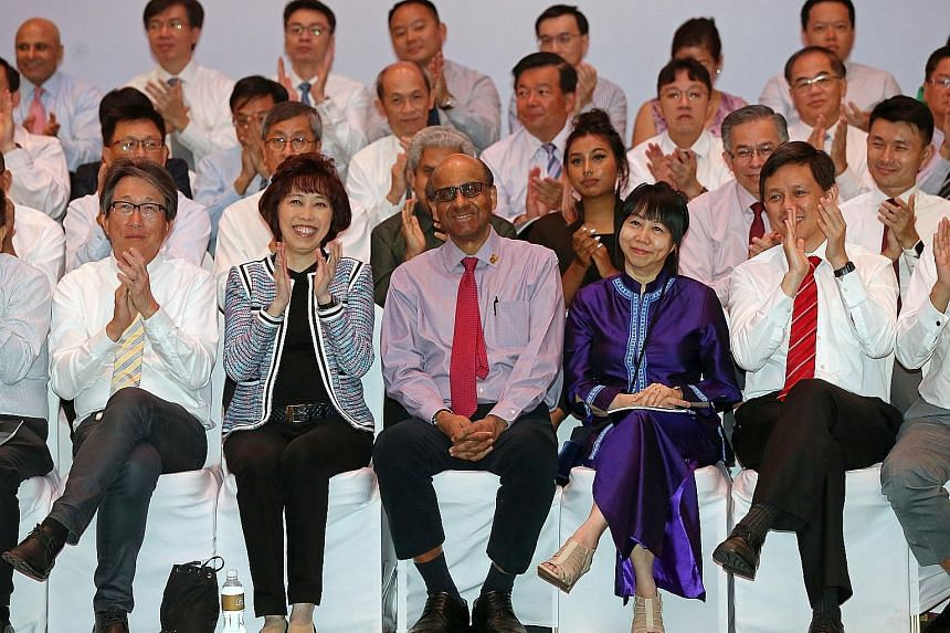 DPM Tharman Shanmugaratnam receiving an ovation after being presented the Medal of Honour for his contributions in improving the lives of workers at the NTUC May Day Awards ceremony yesterday. Beside him are (from left) Minister for Manpower Lim Swee
