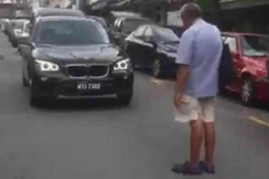 An elderly blind man forced traffic along a street in Malaysia to come to a standstill on Wednesday (May 10) afternoon, refusing to budge unless he was given RM20 (S$ 6.50).