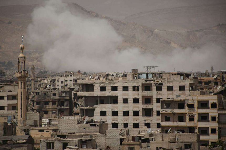Smoke billowing after a reported air strike on reported rebel positions, on April 27, 2017.