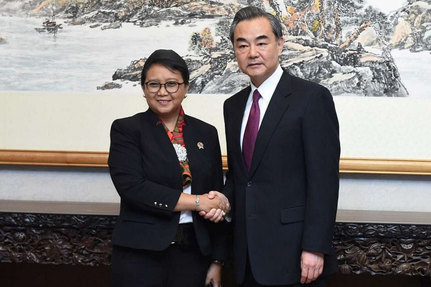 Chinese Foreign Minister Wang Yi meets his Indonesian counterpart Retno Marsudi ahead of the Belt and Road Forum in Beijing on May 13, 2017.