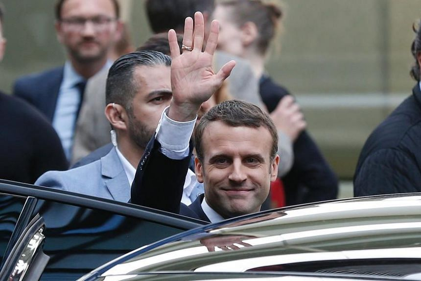Newly elected French president Emmanuel Macron waving as he leaves the Quai Branly museum in Paris on Saturday (May 13).