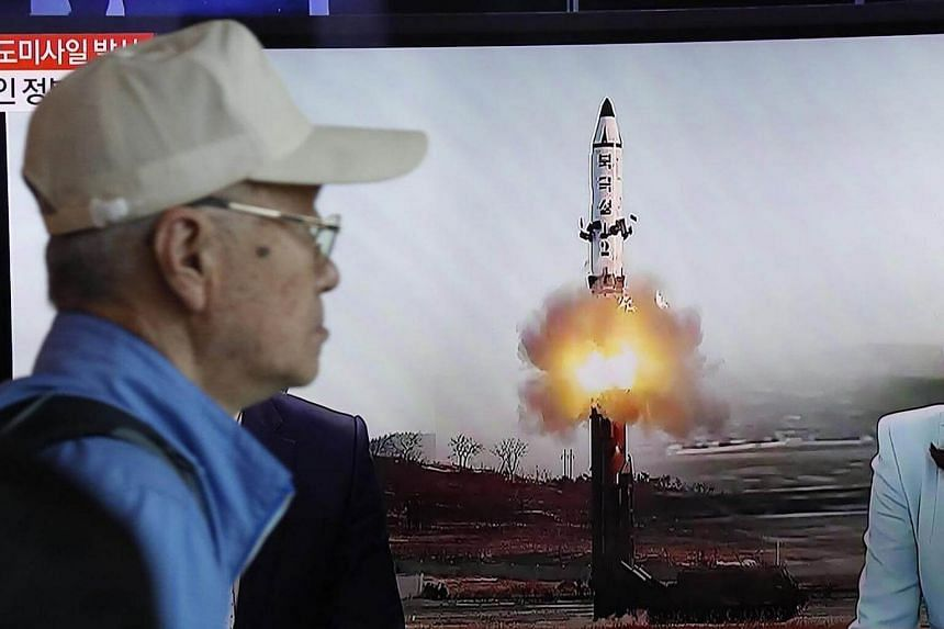 A television in Seoul displays news broadcasts reporting on North Korea's recent ballistic missile launch.