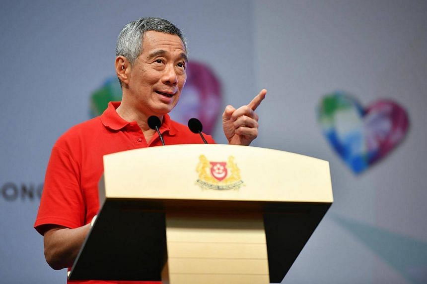 Prime Minister Lee Hsien Loong speaking at the recent May Day Rally at Our Tampines Hub.