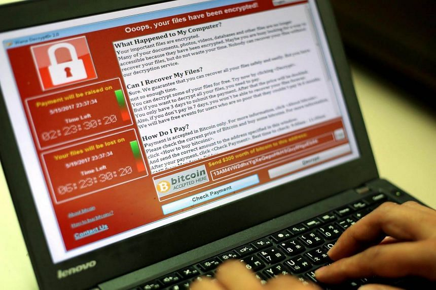 A programmer showing a sample of a ransomware cyberattack on a laptop in Taipei on Saturday (May 13).
