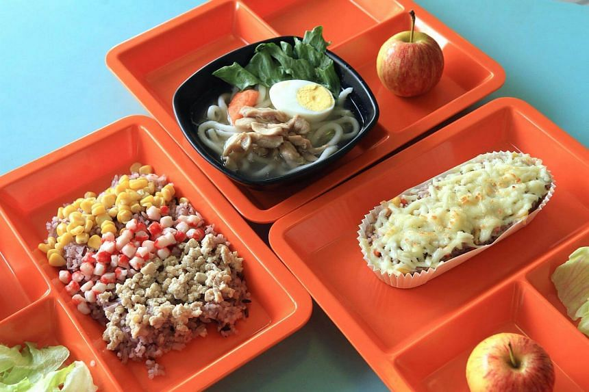 Food offerings from the international cuisine stall at Lianhua Primary School include (clockwise from top) udon noodles, cheesy baked rice and a Japanese rice set.