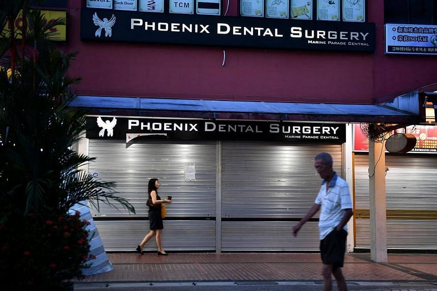 Phoenix Dental Surgery in Marine Parade Central with its shutters down on May 11.