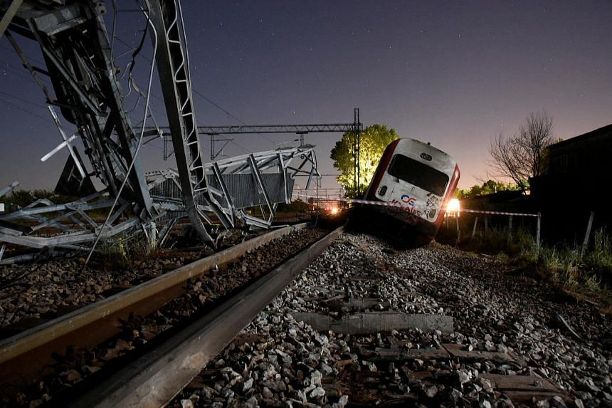 A derailed train carriage is seen toppled in the town of Adendro in northern Greece.