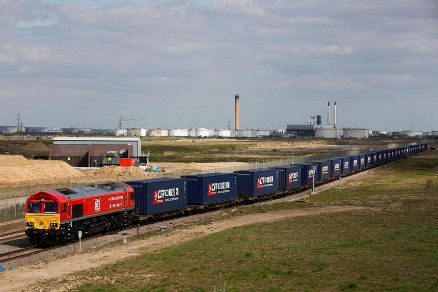 A freight train transporting containers laden with goods from the UK, departs from DP World London Gateway's rail freight depot in Corringham, east of London.