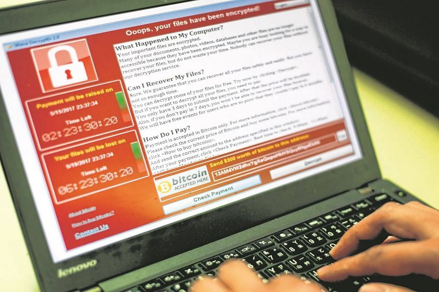 A programmer shows a sample of a ransomware cyberattack on a laptop in Taipei, Taiwan, on May 13, 2017.