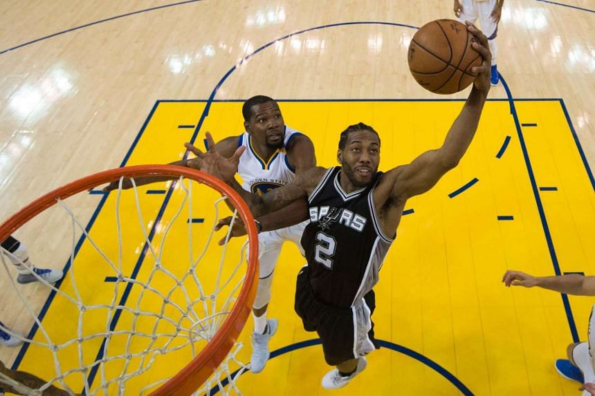 San Antonio Spurs are hoping that star forward Kawhi Leonard (right) will be fit for Game Two of the Western Conference Finals, having suffered an ankle injury in Game One.