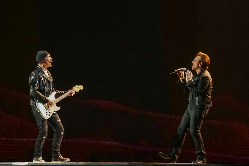 The Edge (left) performs with Bono during the opening concert of U2's global The Joshua Tree Tour 2017 in Vancouver on May 12.