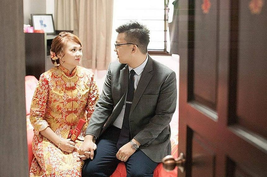 Ms Goh Chieh Ting and her husband on their wedding day last year. The 25-year-old woman, who was six months pregnant, was on her way to the market with her mother-in-law last Saturday morning when she was hit by a lorry.