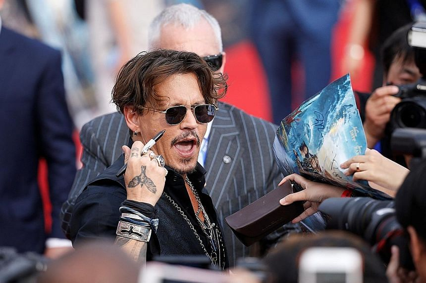 Johnny Depp attending the world premiere of Disney movie Pirates Of The Caribbean: Dead Men Tell No Tales in Shanghai last Thursday.