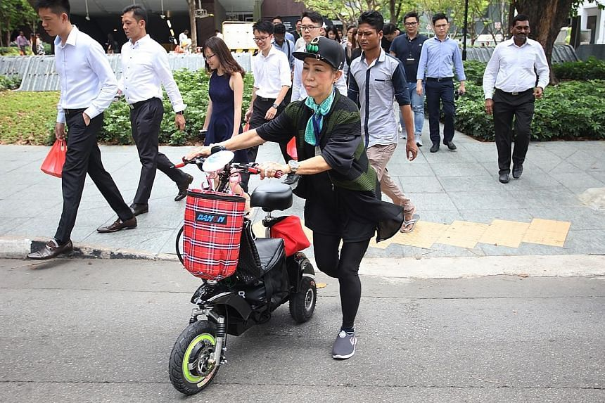 Madam Teo Yoke Lan with the motorised scooter her children gave her as an early Mother's Day gift one month ago.