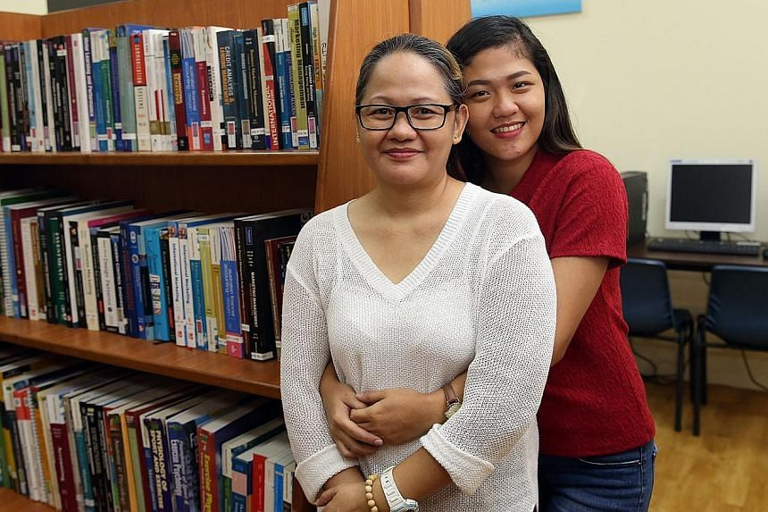 Madam Jean Avila Gadingan and her daughter Jessica celebrated Mother's Day at the Foreign Domestic Worker Association for Social Support and Training clubhouse in Jalan Bukit Merah yesterday. The younger woman had quit her professional job in the Phi