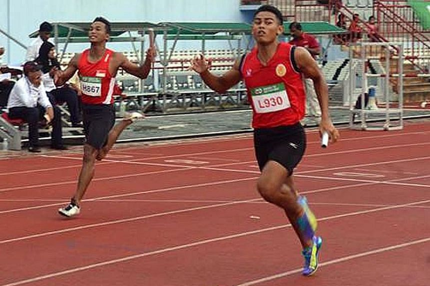 Singapore's Khairyll Amri following Tunku Mahkota Ismail Sports School's Muhammad Aiedel Saadon home in the 4x100m. The quartet need to clock 39.32sec to qualify for the SEA Games.