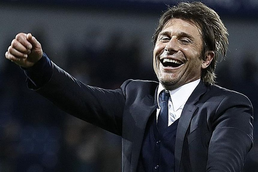 All smiles as Chelsea manager Antonio Conte celebrates winning the Premier League title in his first season with the Blues. He is already planning for new signings to boost the Chelsea squad next season, when they will be playing in the Champions Lea
