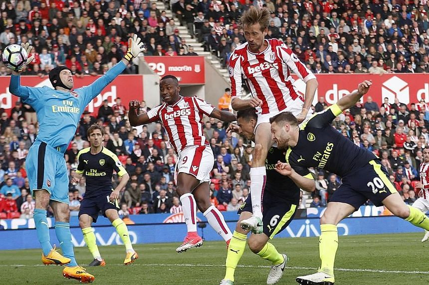 Stoke City striker Peter Crouch (second from right) scoring their lone goal in a 4-1 defeat by Arsenal. Controversy surrounded the goal as Arsenal claimed that Crouch had scored with his hand.