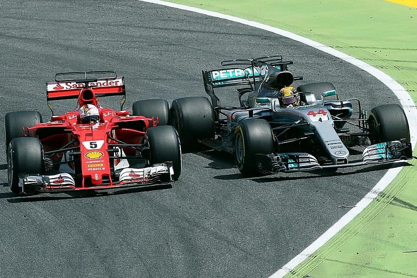 Mercedes' Lewis Hamilton being forced out by Ferrari's Sebastian Vettel as he tries to overtake. The soft tyres made the difference later in the race as the Briton won by 3.4 seconds.