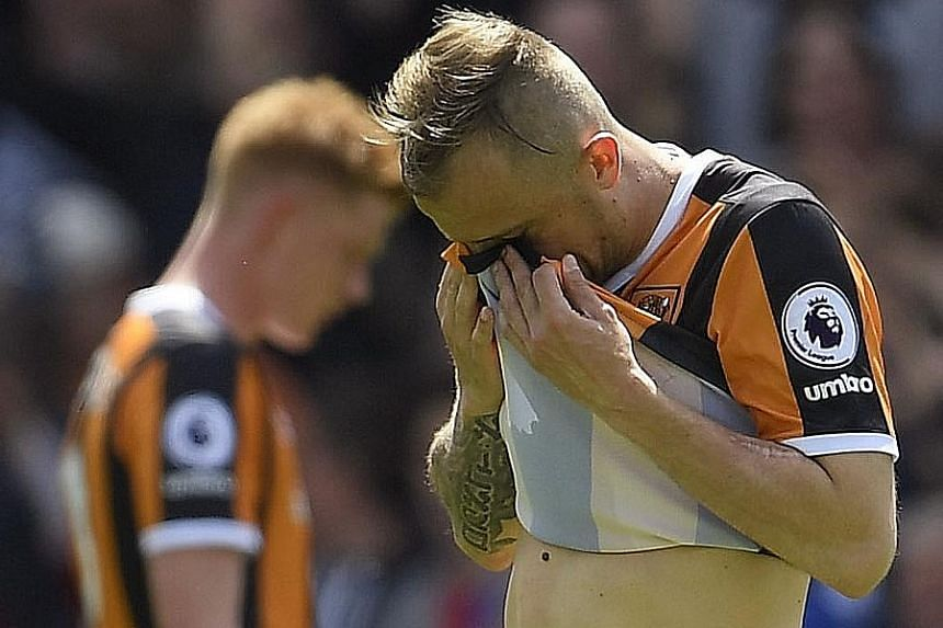 Dejection surrounds Hull City players such as winger Kamil Grosicki, as they are relegated from the Premier League on the penultimate week of the season.