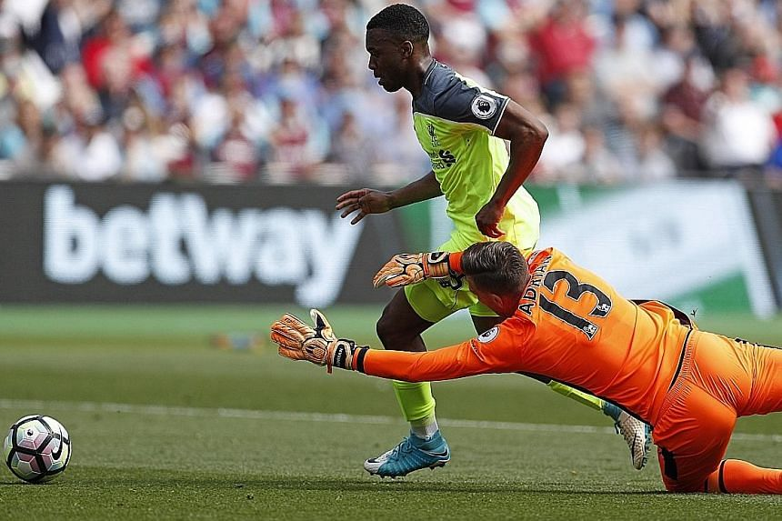Liverpool striker Daniel Sturridge rounding West Ham goalkeeper Adrian to score the opening goal yesterday. It was the Englishman's first goal in 12 matches, as Reds manager Jurgen Klopp handed him a rare start.
