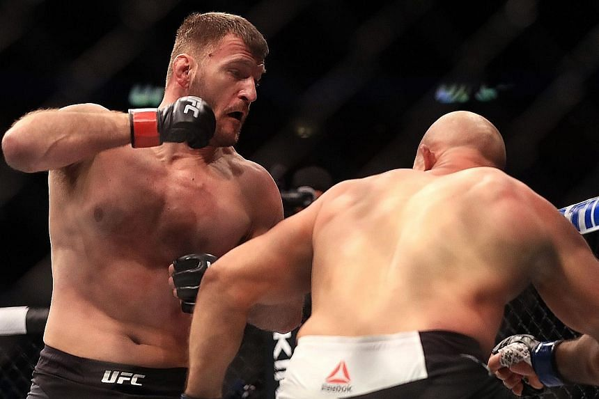 Stipe Miocic about to land a blow on Junior dos Santos in their bout in Dallas, Texas. This was the Croat-American's fourth-straight first-round stoppage win - the best record among current UFC fighters.