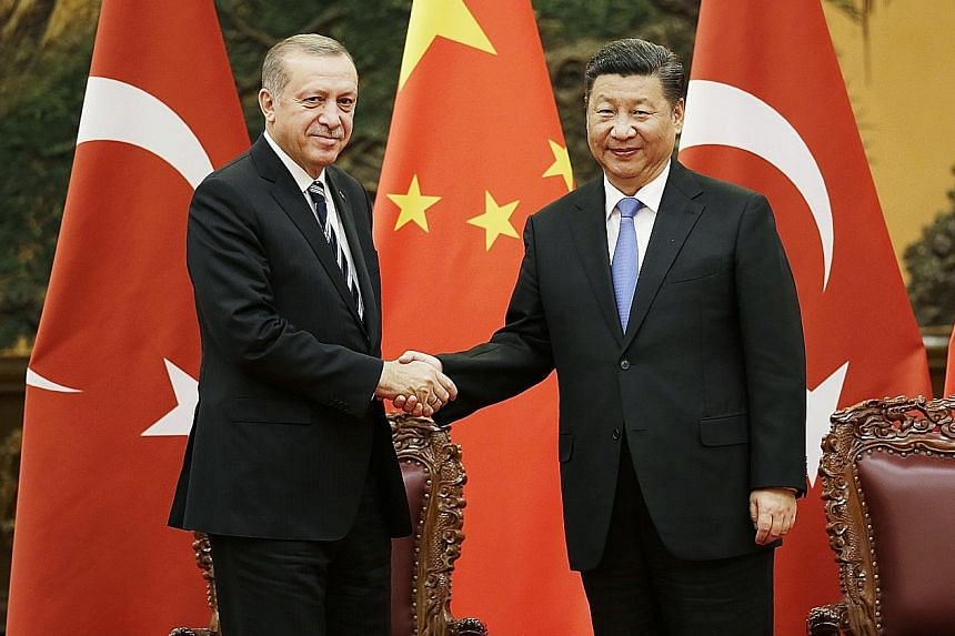 Meeting on the sidelines of the One Belt, One Road summit in Beijing, which ends today, Chinese President Xi Jinping told Turkish President Recep Tayyip Erdogan that developing strategic cooperation was in the interests of both countries. A police of