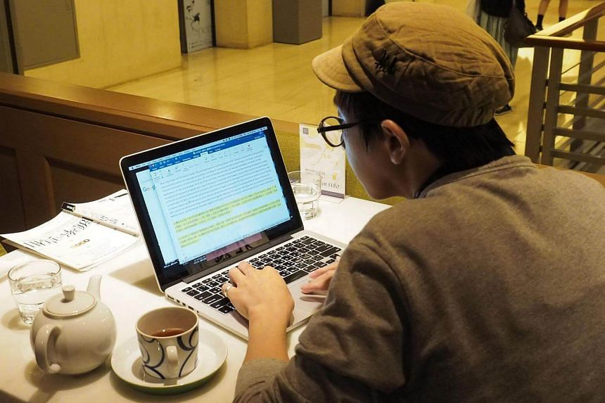 A man using a laptop at the Eslite Bookstore in Taipei, on May 13, 2017.