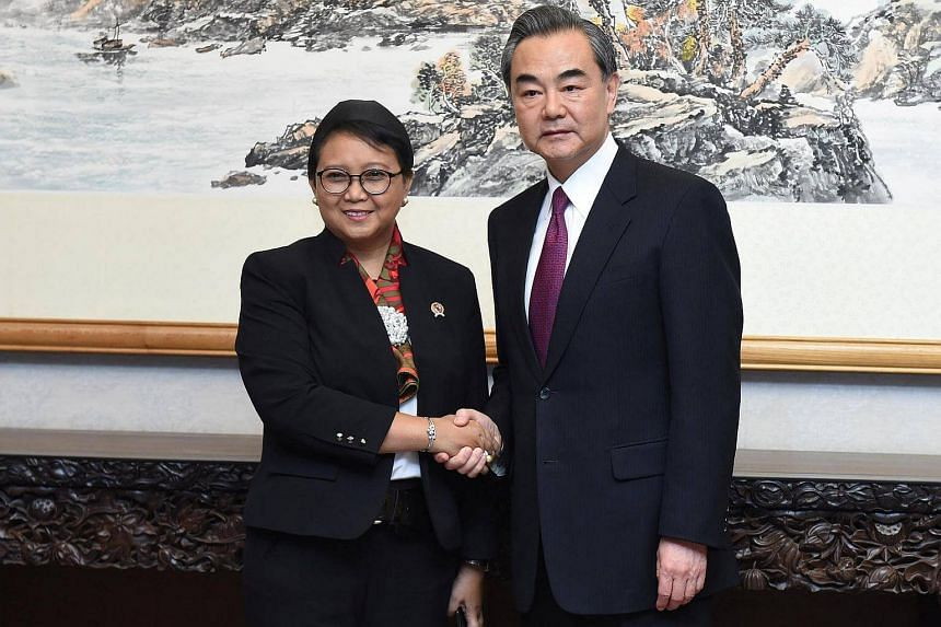Chinese Foreign Minister Wang Yi meets Indonesian Foreign Minister Retno Marsudi ahead of the Belt and Road Forum in Beijing, China May 13.