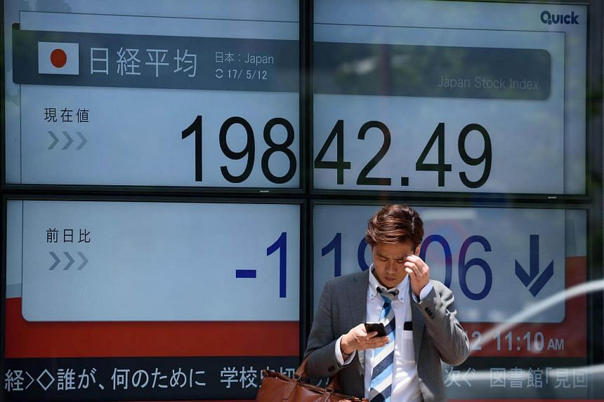An electronic stock board at a securities firm in Tokyo, Japan, on May 12.