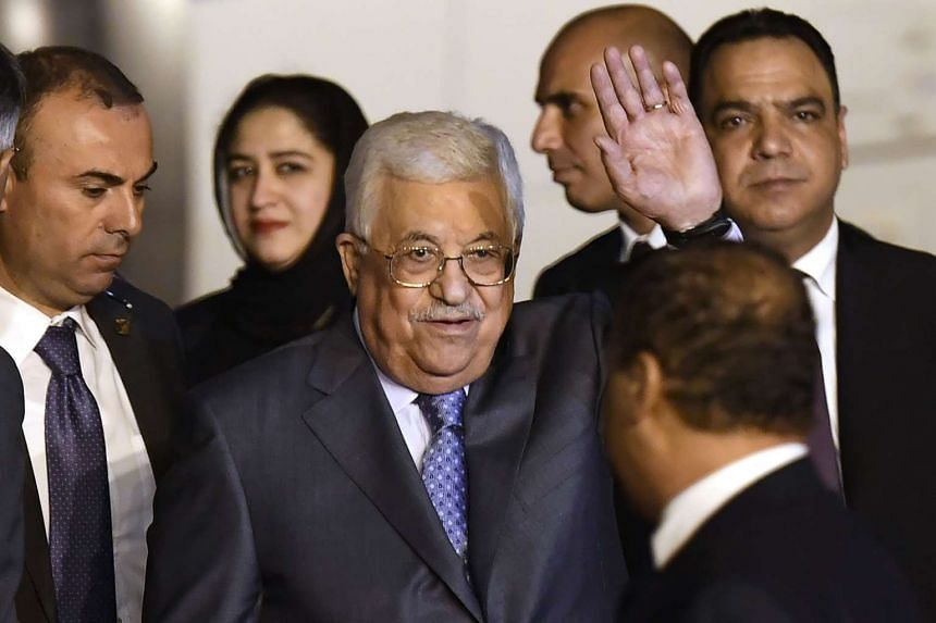 Palestine President Mahmoud Abbas (centre) waves after arriving at Palam Air Force Station in New Delhi on May 14, 2017.