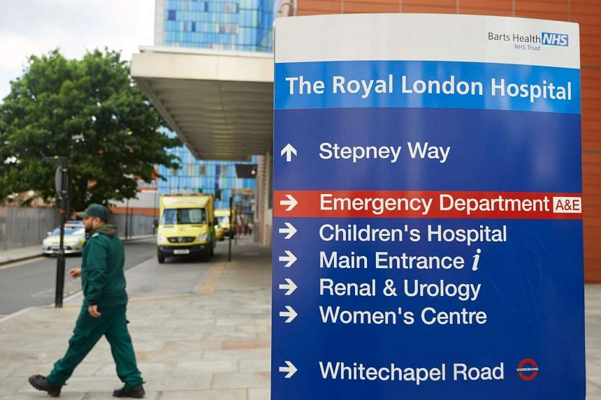 Signage is seen outside The Royal London Hospital in London which was hit by Friday's cyberattack.