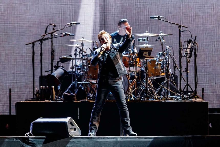 Bono and Larry Mullen Jr of rock band U2 perform during their 'The Joshua Tree World Tour' opener on May 12, 2017 in Vancouver, Canada.