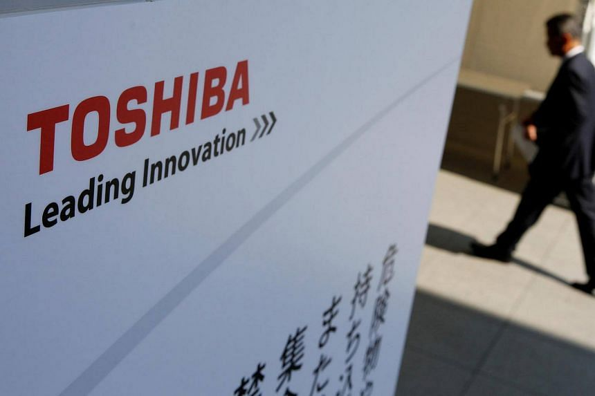 The logo of Toshiba is seen as a shareholder arrives at Toshiba's extraordinary shareholders meeting, on March 30, 2017.
