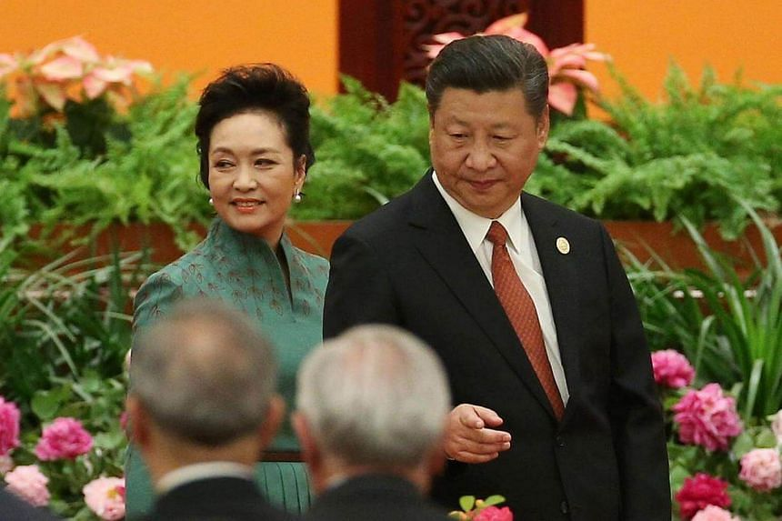 Chinese President Xi Jinping (right) and his wife Peng Liyuan arrive for a welcome banquet for the Belt and Road Forum, on May 14, 2017.