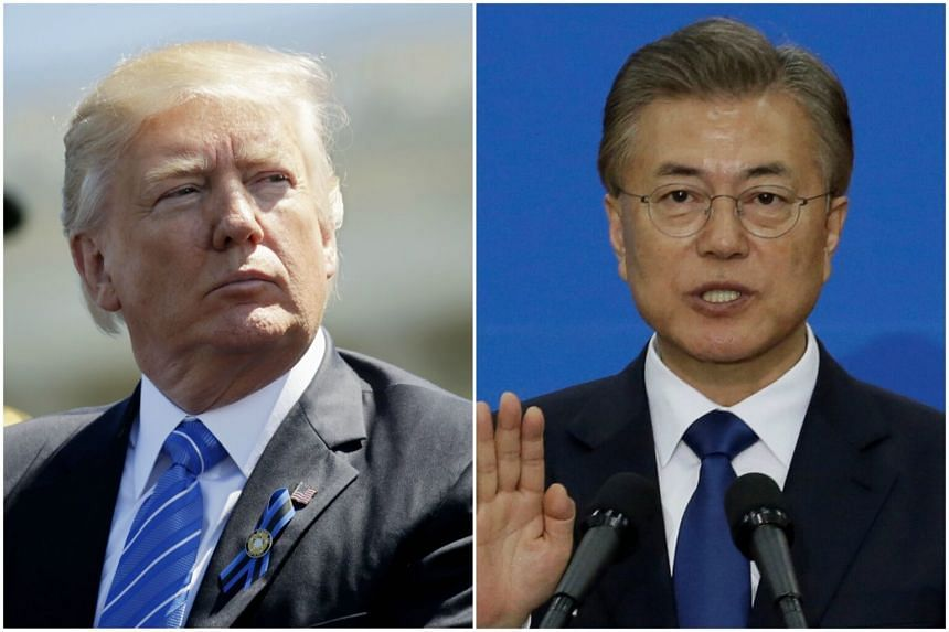 New South Korean President Moon Jae In (right) will visit Washington in late June for a summit with US President Donald Trump (left).