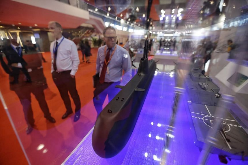 Visitors looking at the model of a Type-218SG submarine, which will be added to the Republic of Singapore Navy's fleet from 2024, during the Imdex Asia 2017 Maritime Defence Show at Changi Exhibition Centre on May 16, 2017.