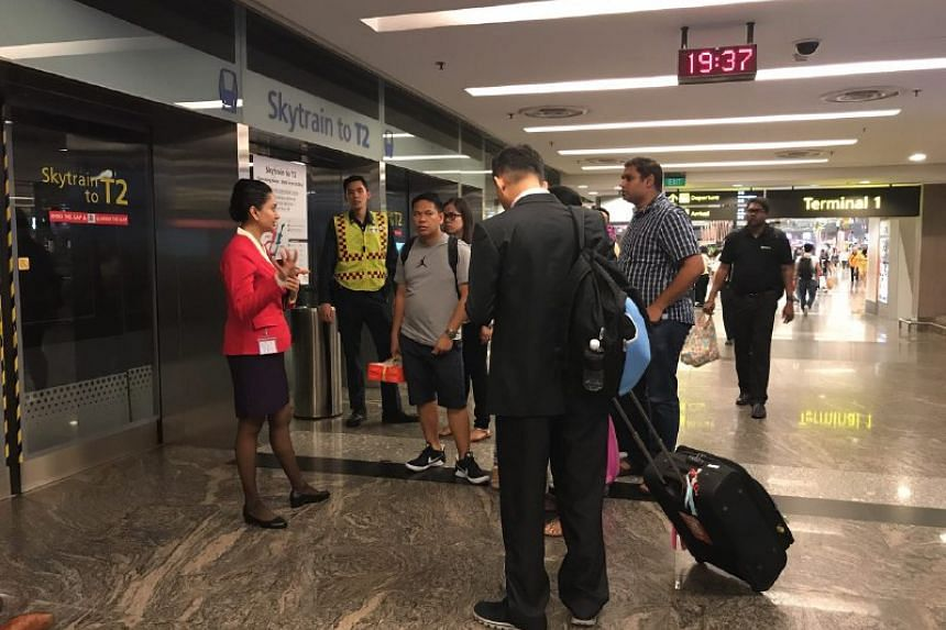The skytrain to Terminal 2 was not in service after the fire broke out, with smoke coming from an air-conditioning vent.