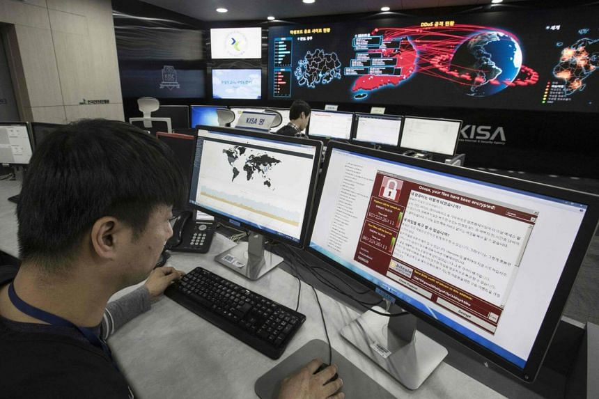 Staff monitoring the spread of ransomware cyber-attacks at the Korea Internet and Security Agency (KISA) in Seoul, on May 15, 2017.