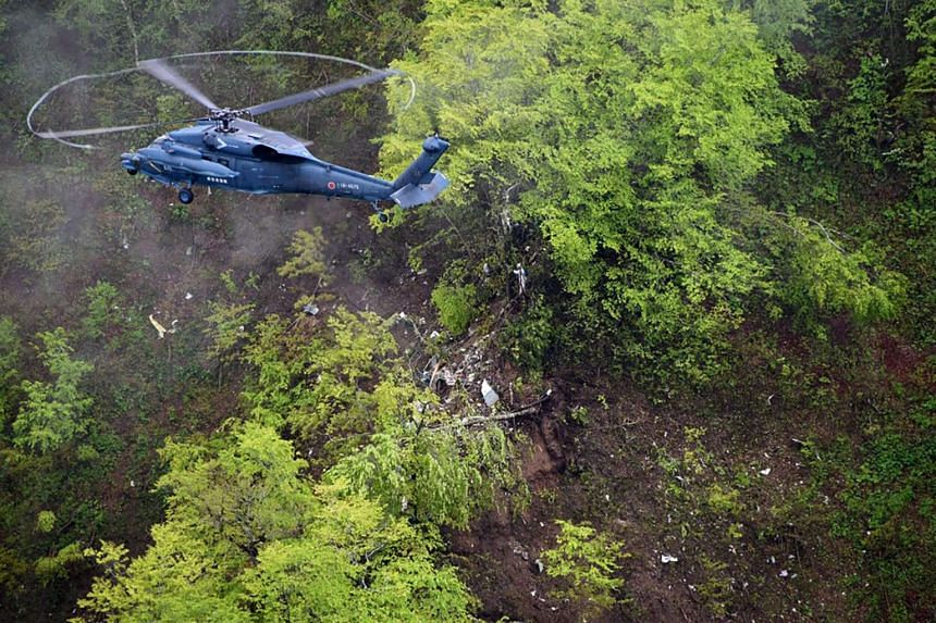 This handout picture provided by the Japanese Defence Ministry/Self Defence Force on May 16, 2017 shows the plane crash site in a mountainous region on the northern island of Hokkaido.