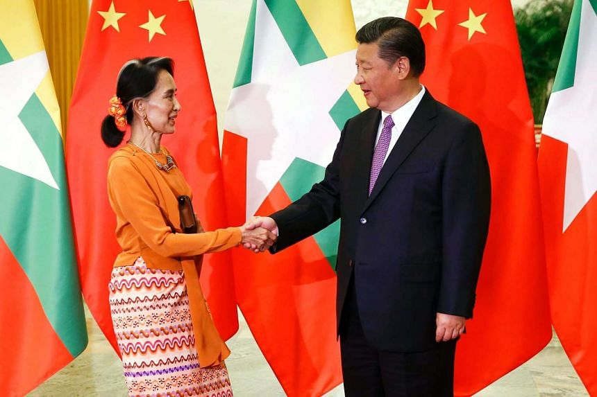 Myanmar State Counsellor Aung San Suu Kyi (left) shakes hands with Chinese President Xi Jinping (right) as they meet at the Great Hall of the People in Beijing, China, on May 16, 2017.