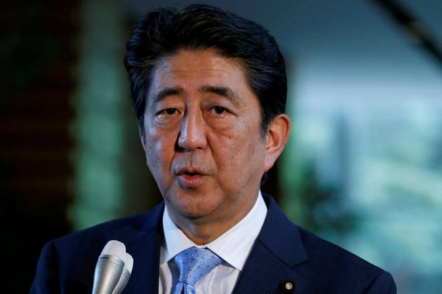 """Mr Abe urged global policymakers not to view trade as a """"zero-sum"""" game, but instead seek to remove barriers that hamper innovation from crossing borders."""