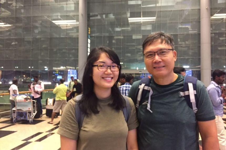 Engineer Yip Peng Sun, 55, and his daughter 21-year-old undergraduate Yip Zhi Ting. They heard about the closure at T2 while on their way to the airport, so they headed to Terminal 3 instead.