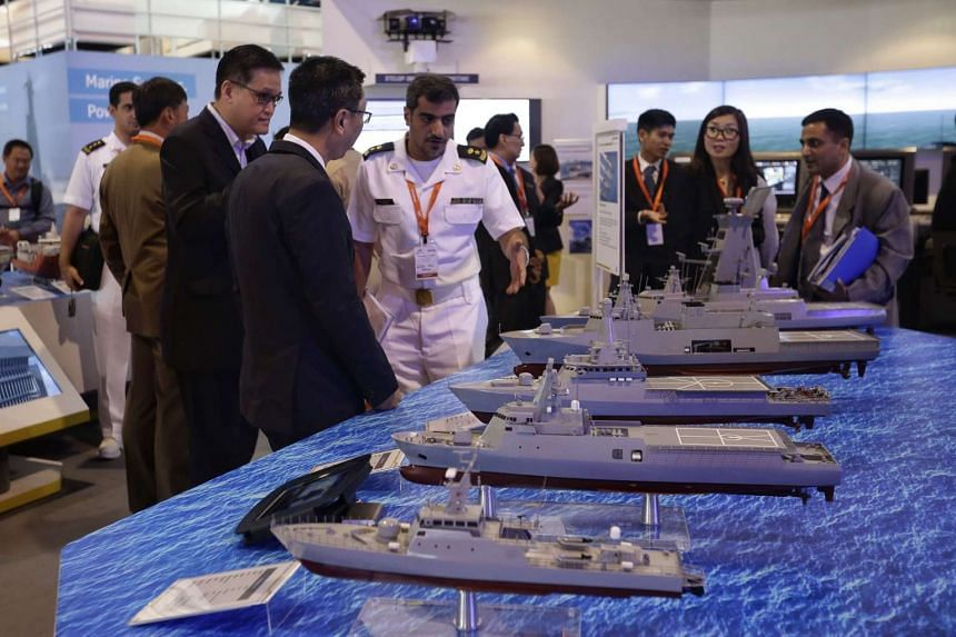 Visitors browsing the exhibits, such as the models of the Vanguard series and Independence 80, at ST Engineering's booth during the Imdex Asia 2017 Maritime Defence Show at Changi Exhibition Centre on May 16, 2017.