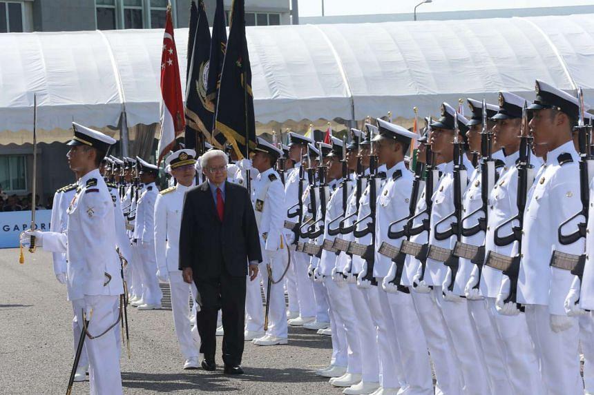 President Tony Tan Keng Yam reviewing the guard of honour at Changi Naval Base.