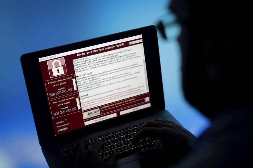 A lock screen from a cyber attack warns that data files have been encrypted on a laptop computer.