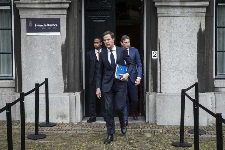 Dutch Prime Minister Mark Rutte  leaves The Hague after negotiations over  the formation of a Cabinet among the Liberals, the Christian Democrats, the centrist D66 party and the Greens  on May 15.