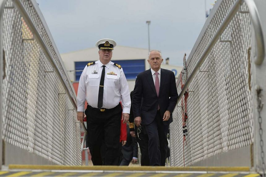 Prime Minister Malcolm Turnbull  tours a Hobart Class Air Warfare Destroyer with Navy representative Craig Bourke   during a visit to the ASC naval shipyard in Osborne, South Australia on May 16.